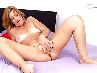 Matures Masturbating On The Couch